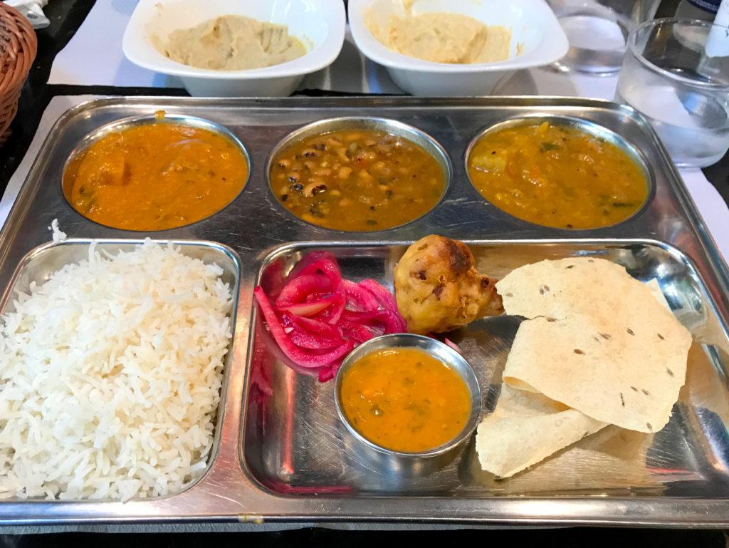 Vegan Indian food on a metal tray.