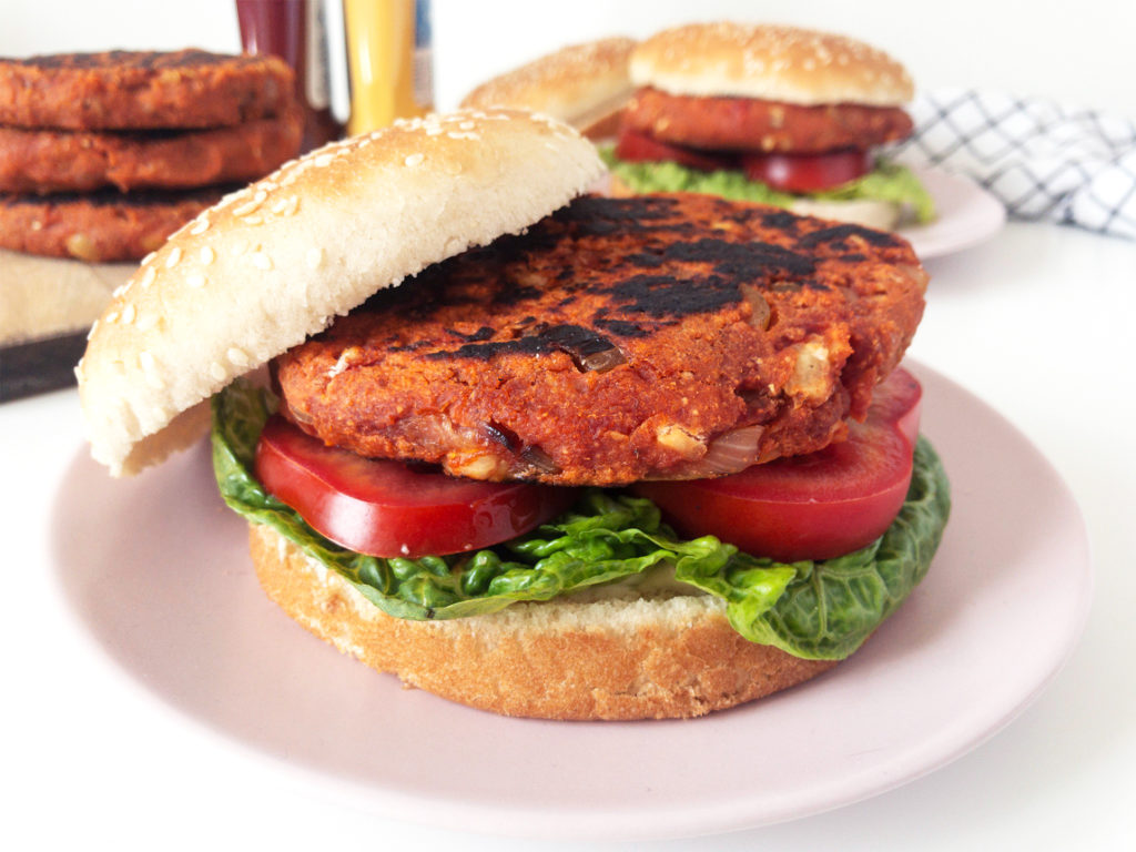 Classic Chickpea Veggie Burgers with lettuce, tomato, and a sesame seed bun