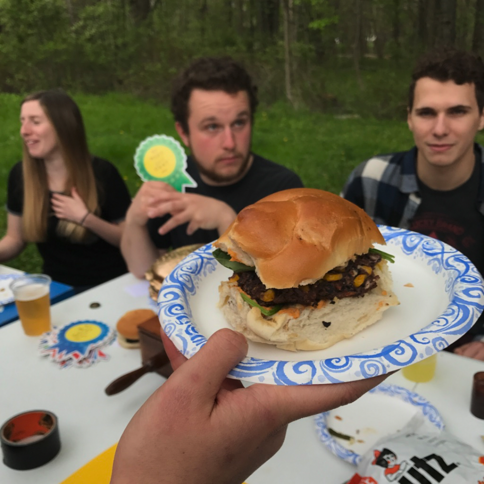 Frat party cookout judges awarding the second place best burger a ribbon