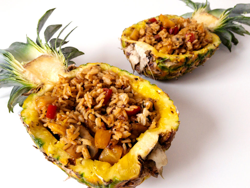 Easy vegan pineapple fried rice in a pineapple bowl.