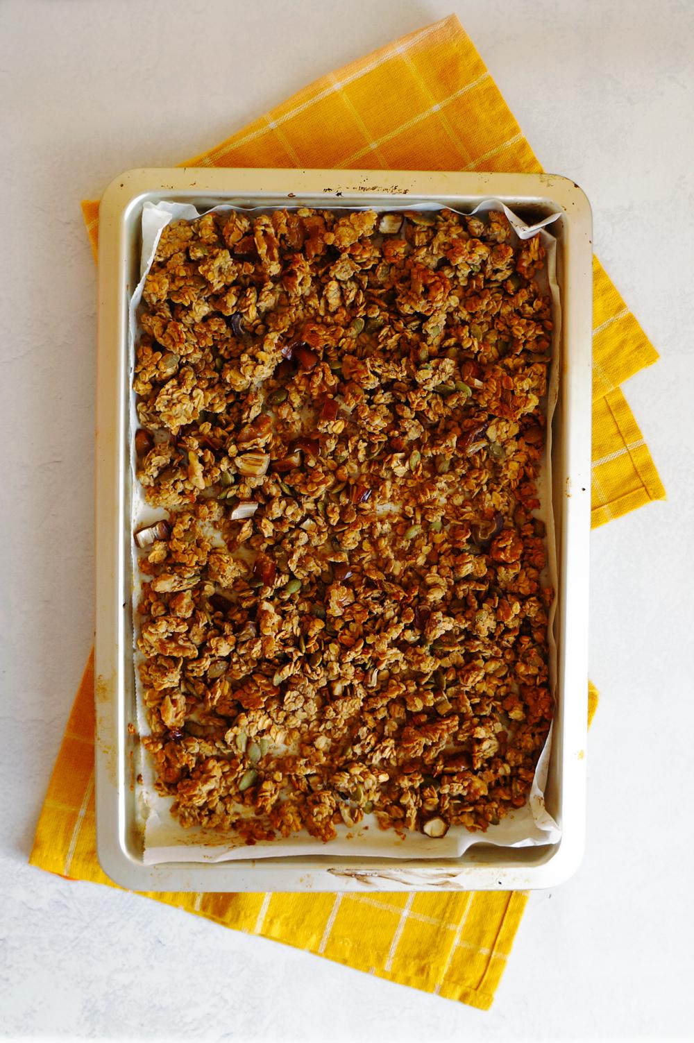 Banana bread granola on a baking tray.