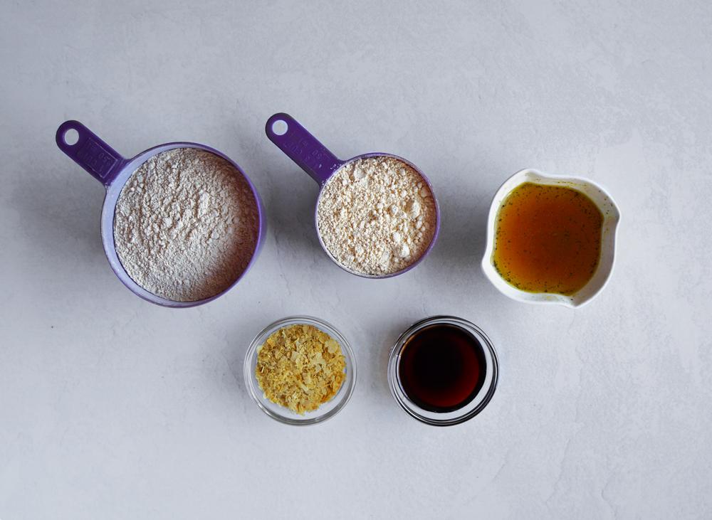 Ingredients to make seitan: vital wheat gluten, chickpea flour, vegetable broth, nutritional yeast, soy sauce