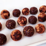 Chocolate walnut bliss balls on a tray