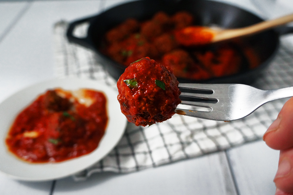 Vegan high-protein textured vegetable protein (TVP) meatball on a fork.