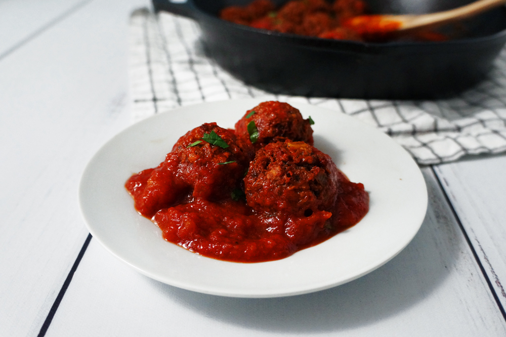 Vegan high-protein textured vegetable protein (TVP) meatballs on a small white plate.