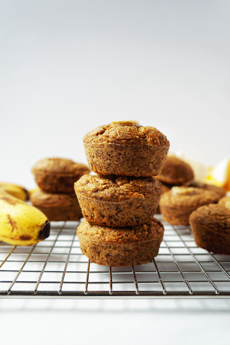Thee healthy vegan, gluten-free banana bread muffins stacked on top of each other.