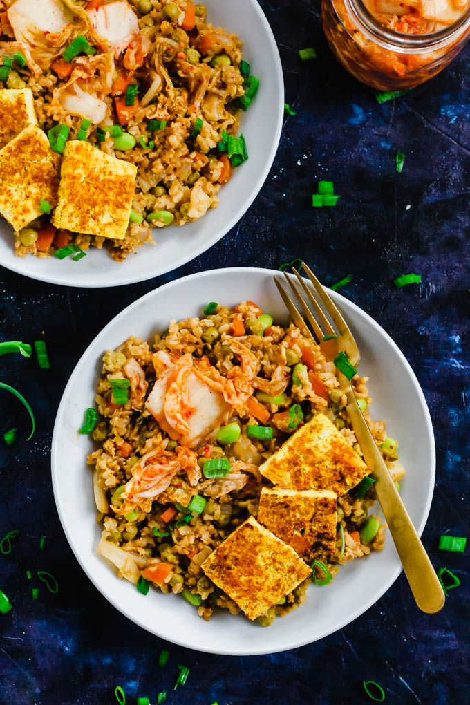 A great vegan pantry recipe – Korean Kimchi Fried Rice in white bowls.