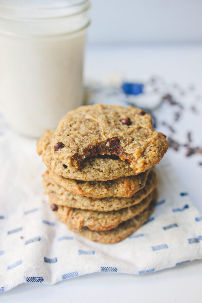 A great vegan pantry recipe – A stack of tahini chocolate chip cookies with a glass of vegan milk.