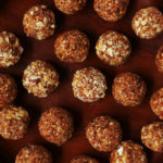 A close up of the salted caramel energy balls rolled in finely chopped cashew pieces.