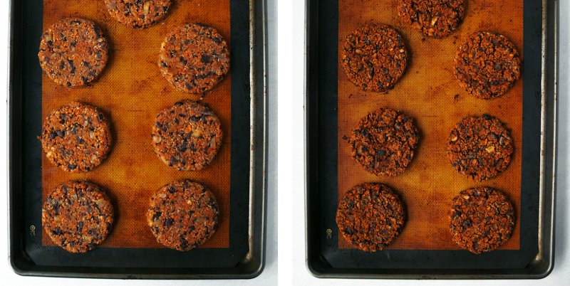 Black bean burger patties on a baking tray lined with a reusable silicone mat.