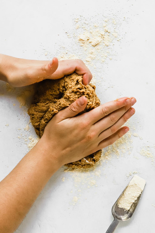 Kneading a ball of seitan dough for seitan sausages.
