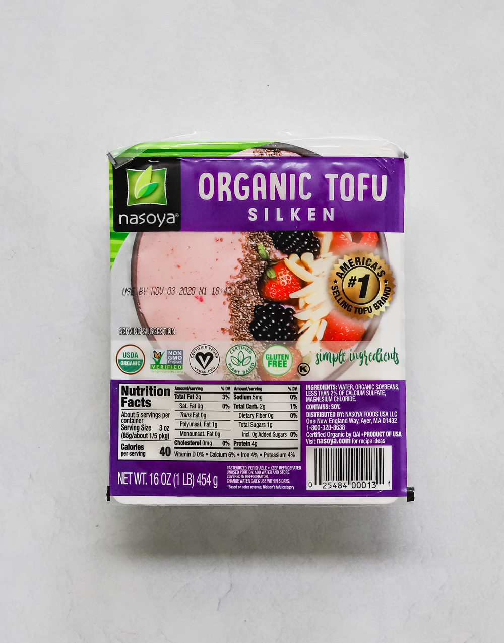 Nasoya silken tofu package on a white surface.