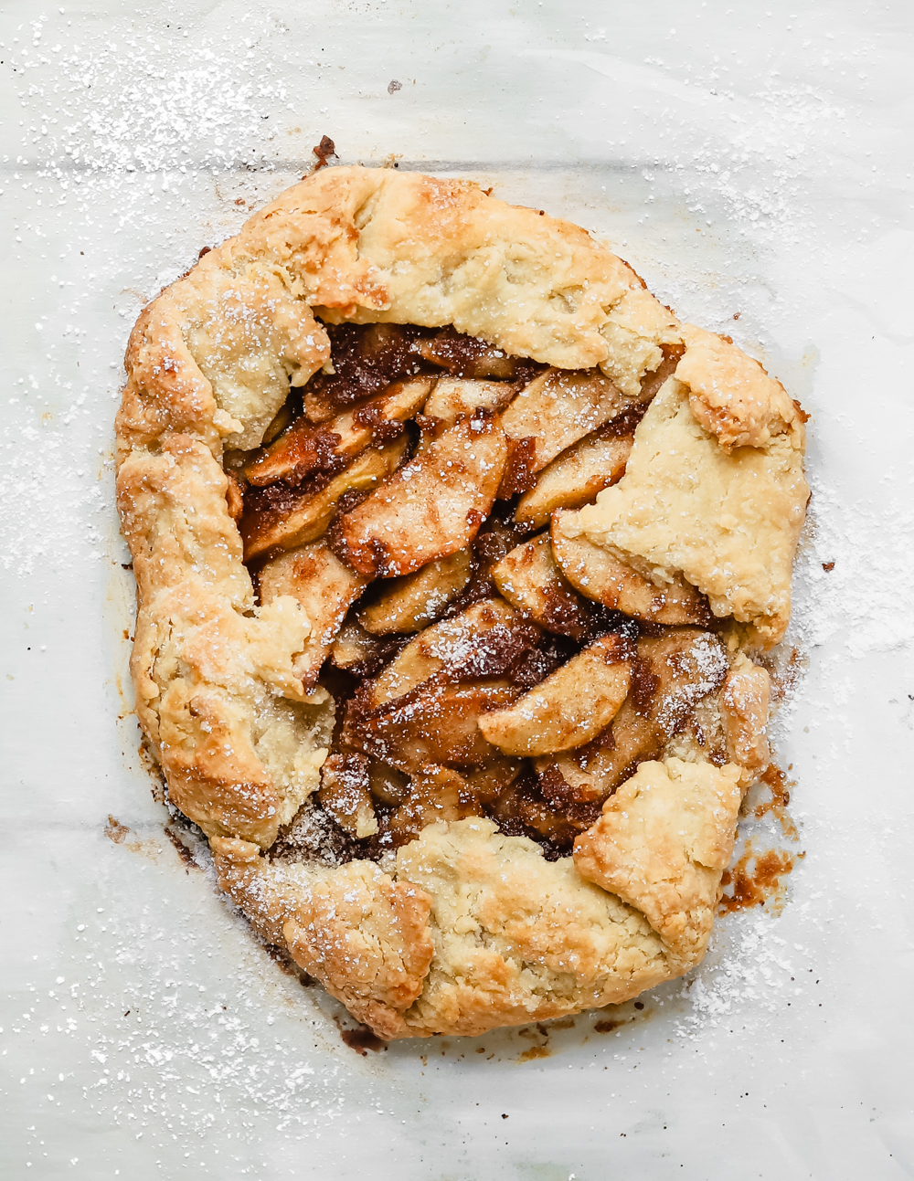 Delicious easy vegan apple galette with a gooey apple pie filling and a flaky golden crust.