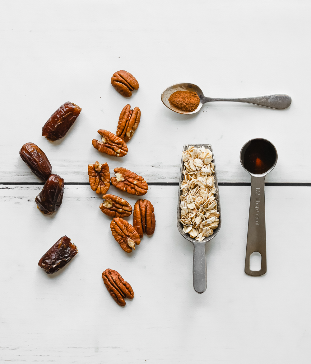 Ingredients to make quick and easy vegan pecan pie bites: dates, pecans, oats, cinnamon, and maple syrup.
