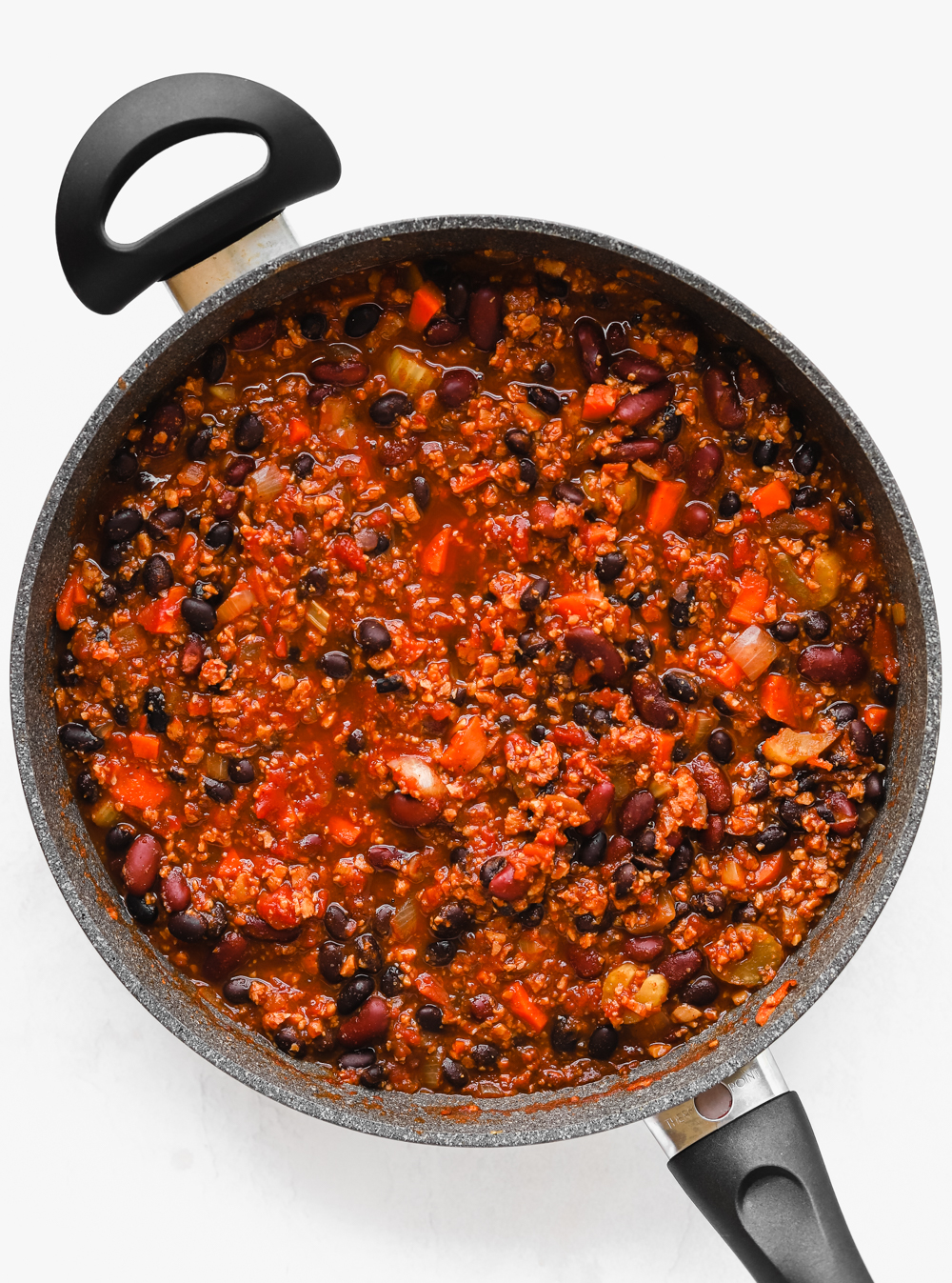 Big pot full of delicious meaty tvp chili with beans and vegetables.