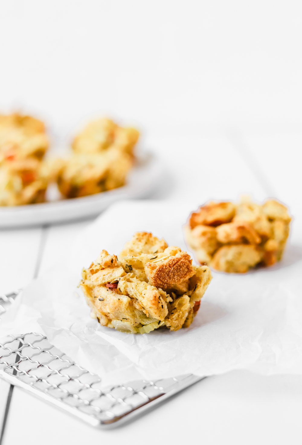 Delicious crispy stuffing muffins on a cooling rack.
