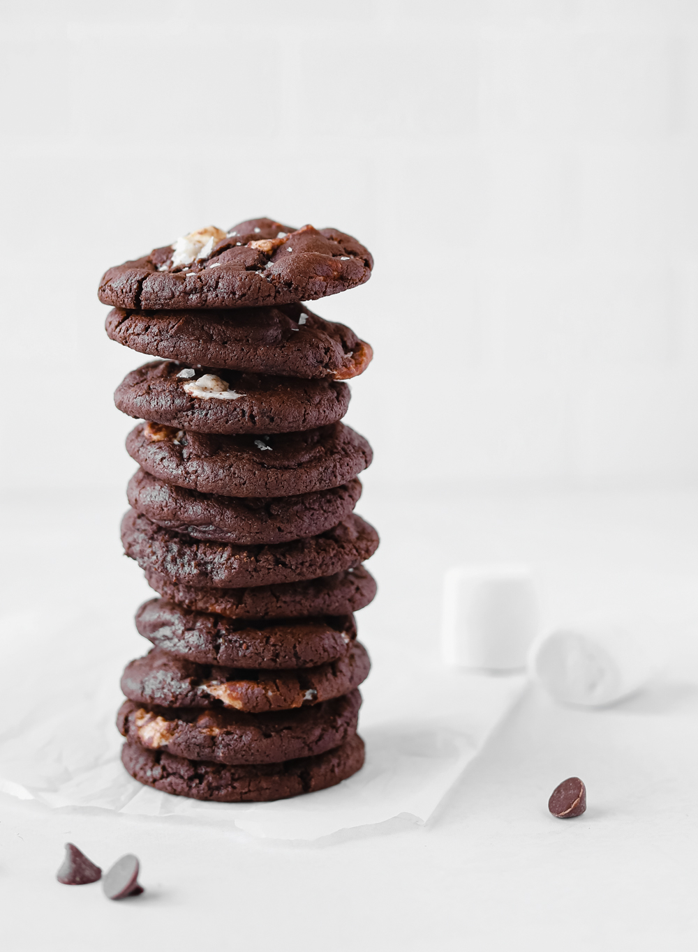 Vegan hot chocolate cookies stacked on top of eachother.