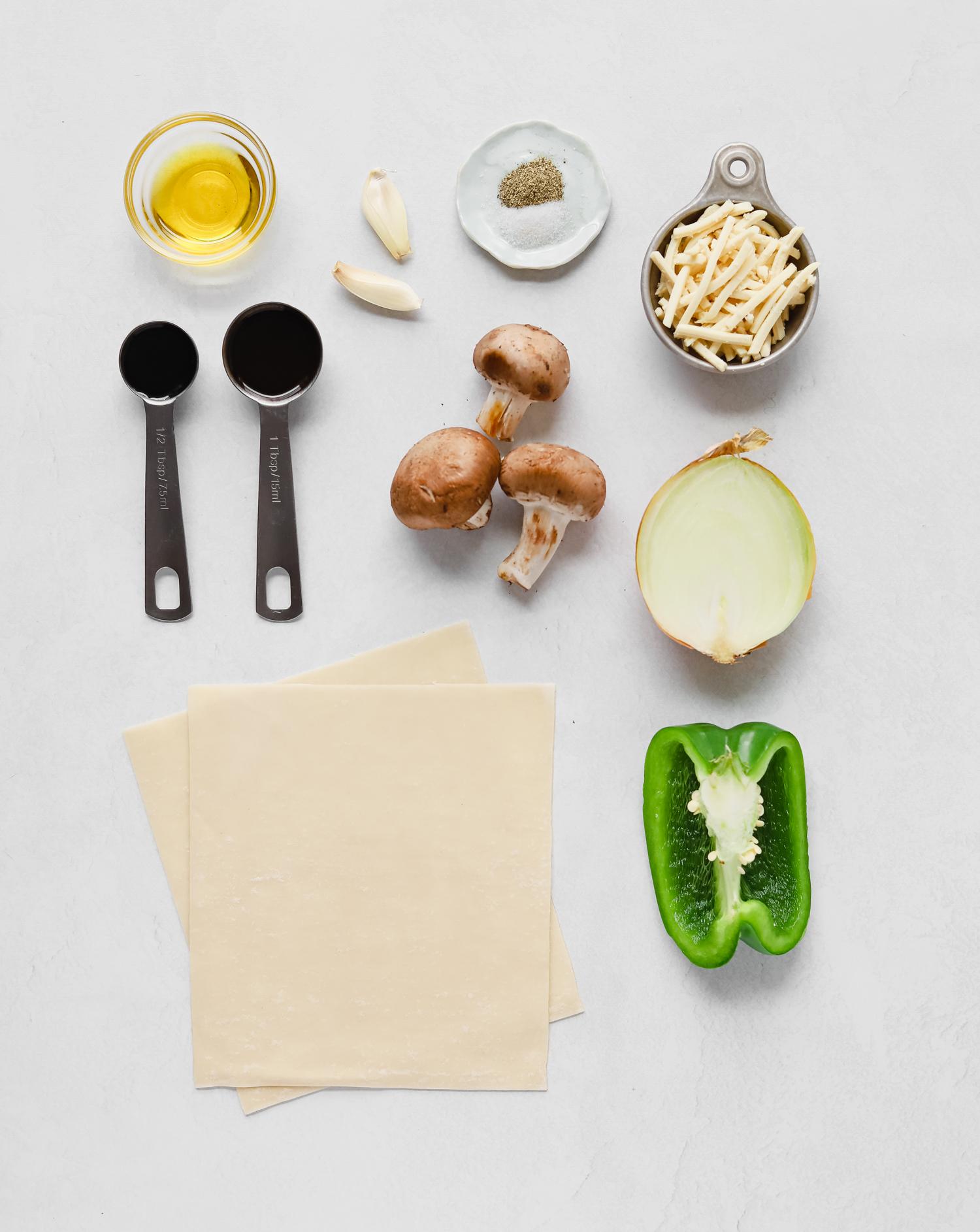 Ingredients to make mushroom phill cheesesteak egg rolls