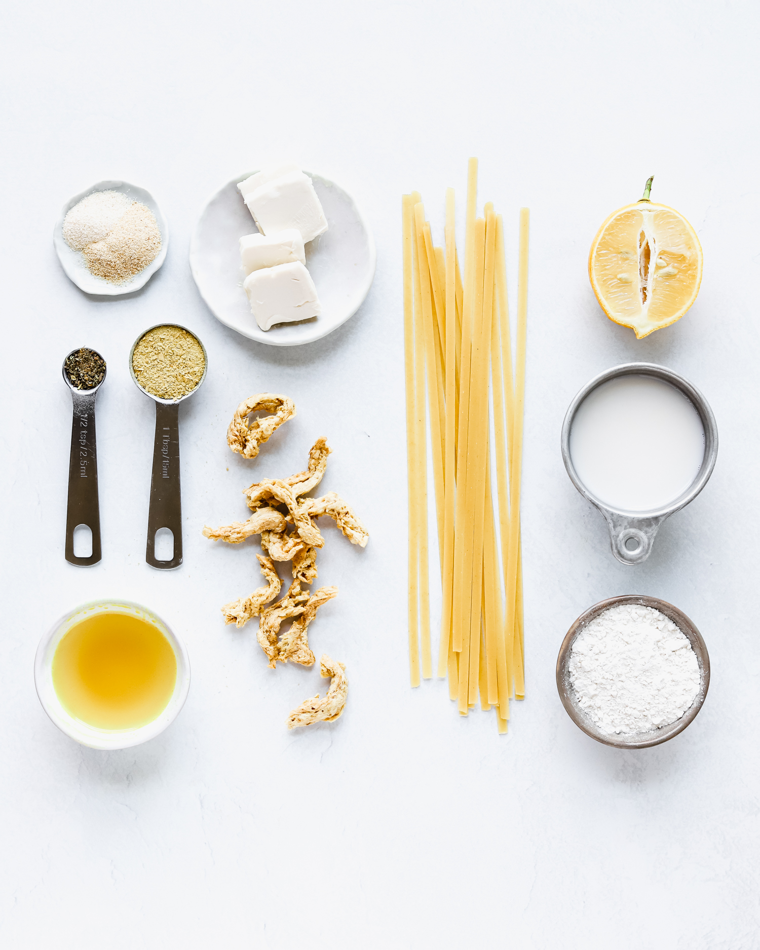Ingredients to make healthy vegan fettuccine alfredo pasta with soy curls